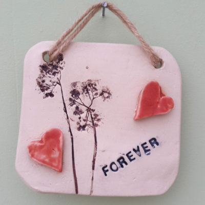 forever ceramic wall hanging