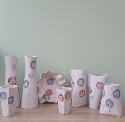 ceramic vases with red and blue dandelion design