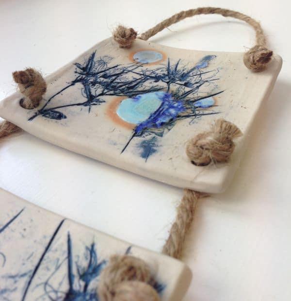 moonlit meadow ceramic wall hanging