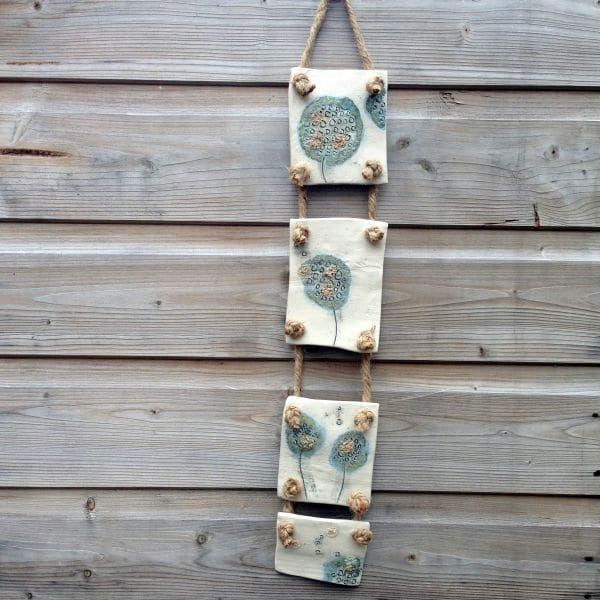 panelled ceramic dandelion wall hanging