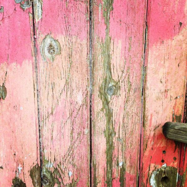 distressed pink wooden door