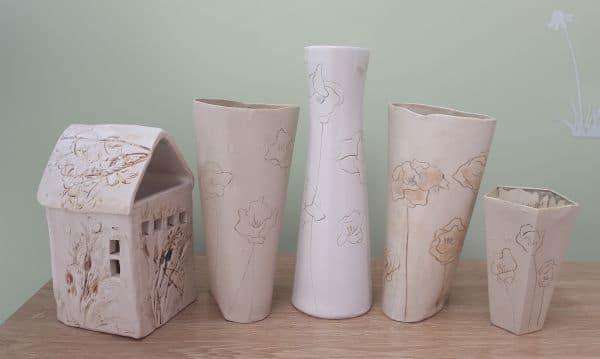 ceramic flower vases and house