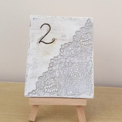 lace table number tile on easel