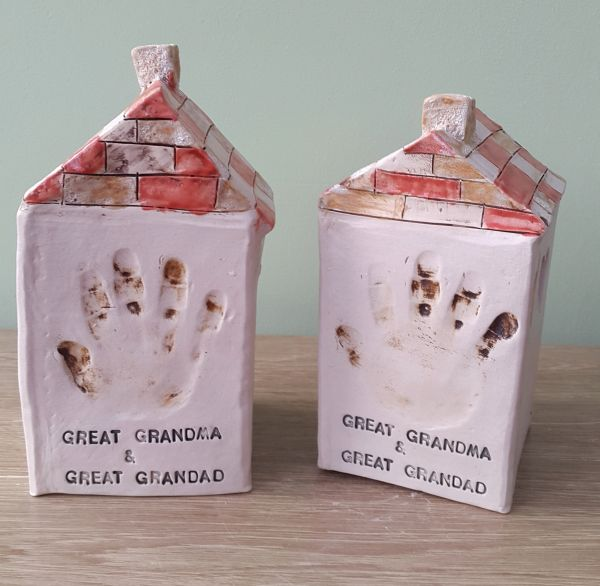 child hand prints in ceramic tea light houses