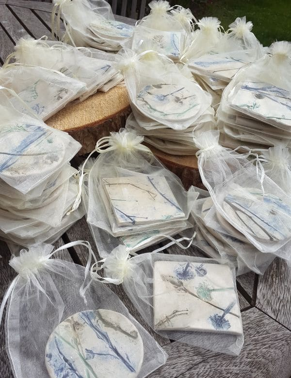 The finished order of 70 coasters in organza gift bags