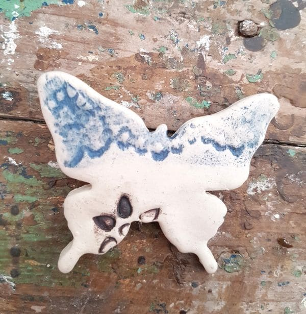 blue lace flower ceramic butterfly brooch