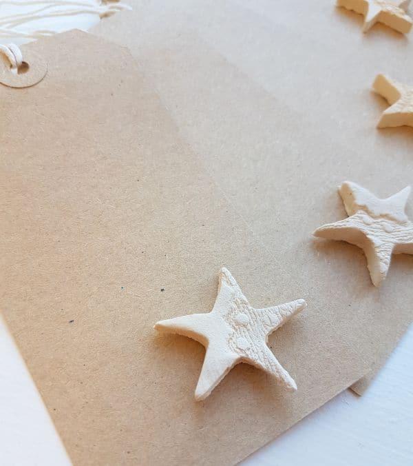 white ceramic stars on gift tags