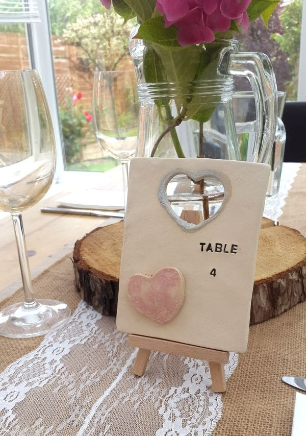 pink heart ceramic tile wedding table number