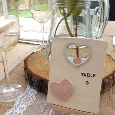 table number tile with hearts