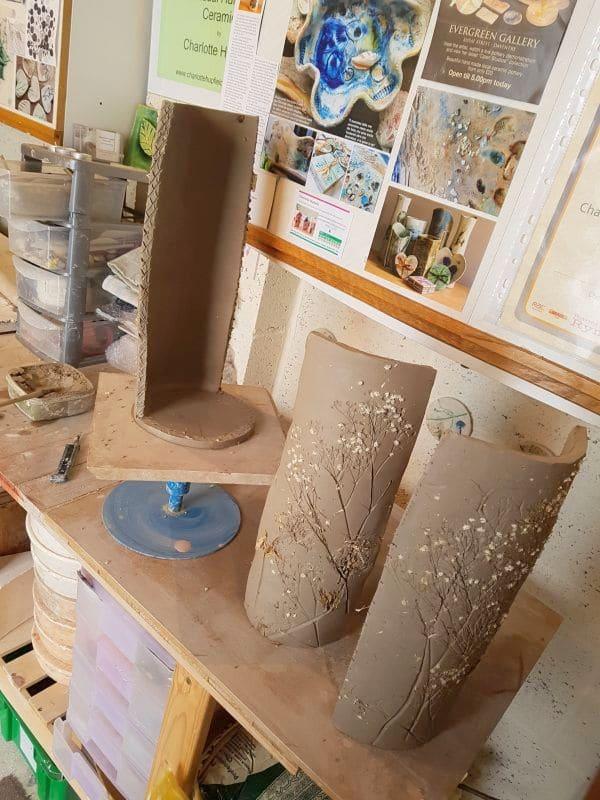 hand building a vase