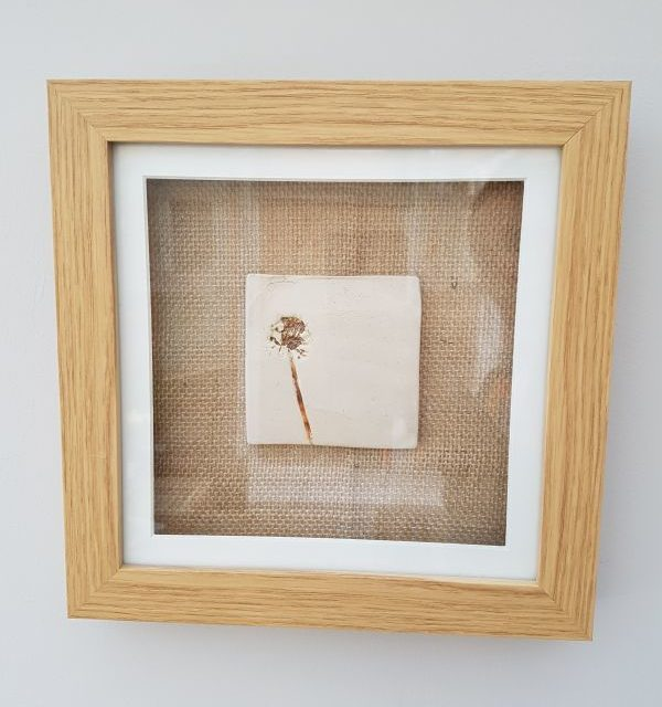framed ceramic dandelion tile