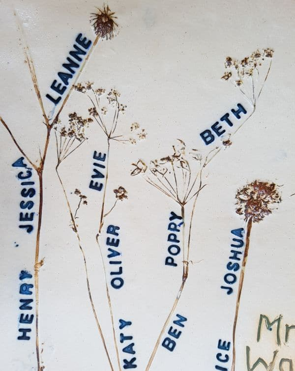 school pupils names stamped into clay