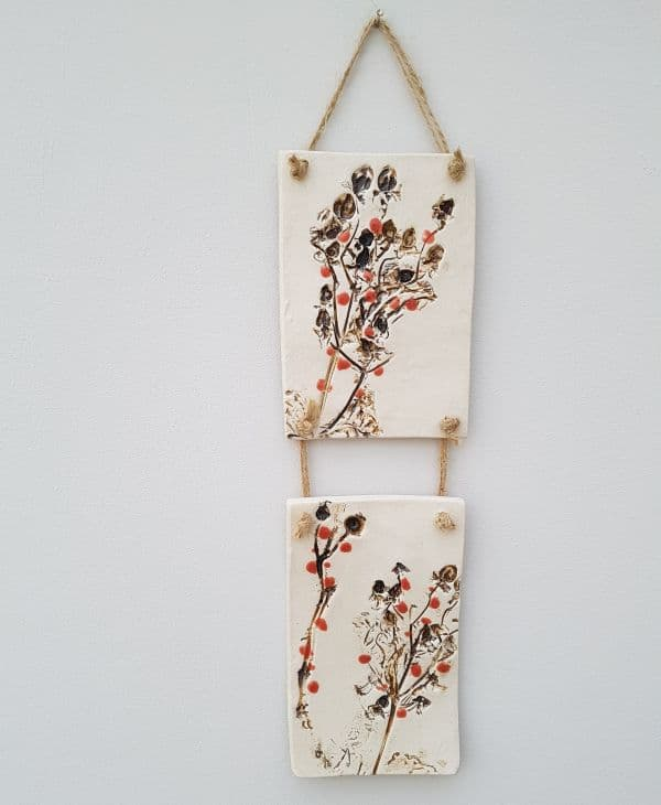 red berries ceramic wall hanging