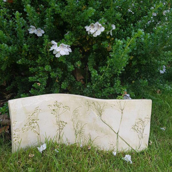 green botanical ceramic curved art