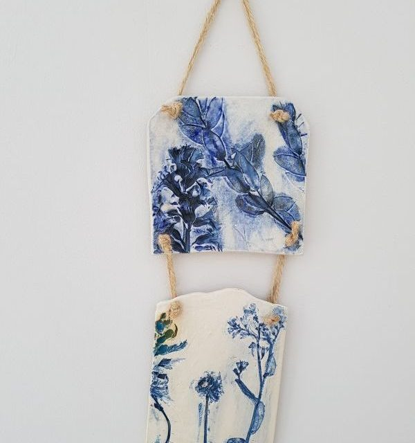 blue botanical ceramic wall hanging