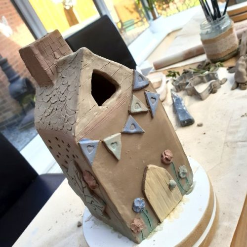 tea light house with bunting