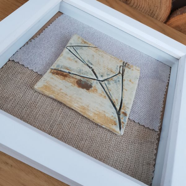 botanical ceramic tile in frame
