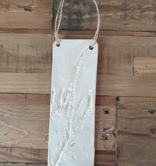 white flower plaque