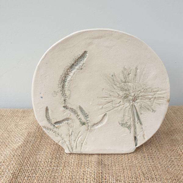grey flowers round ceramic vase