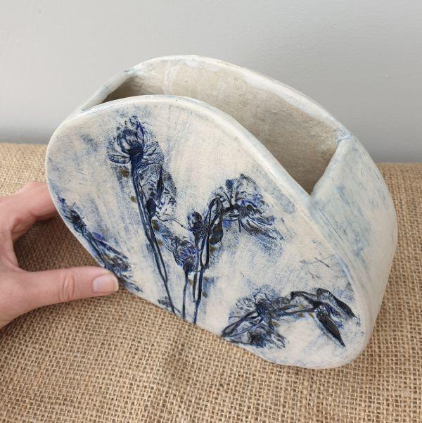 blue flowers round vase