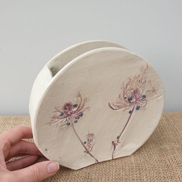 round floral ceramic vase