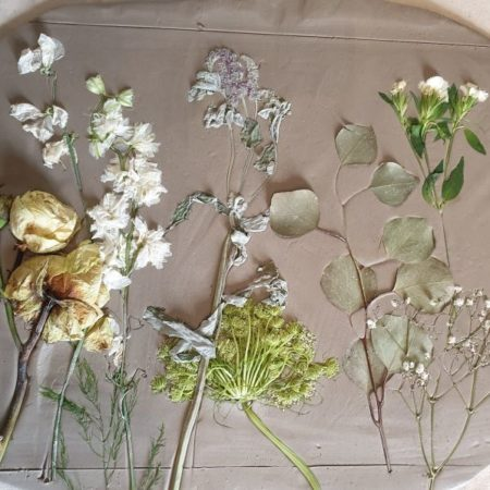 flowers pressed into clay