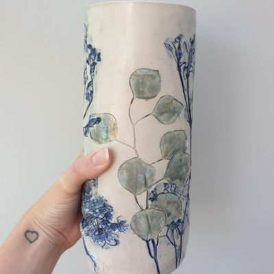 wedding flowers pressed into clay to make vase