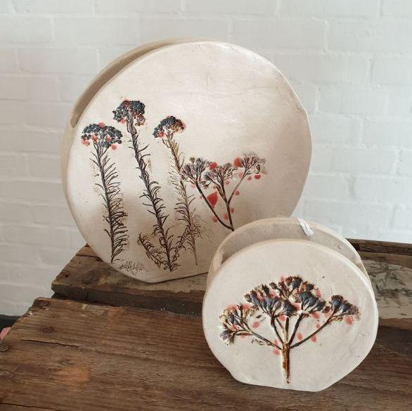 red berries round vase